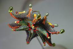 Geometric bead bracelet by Gail Crosman Moore.  Stunning!