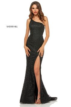 2210722610 Sherri Hill 52554 One Shoulder High Slit Prom Dress Style 52554 from Sherri  Hill is a one shoulder fitted embellished prom gown with a high leg slit.