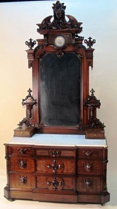 FINELY CARVED VICTORIAN CHEST MIRROR: Renaissance Revival I have an renaissance revival american victorian dresser in my master bedroom and I really never tire of looking at it while reading in bed.