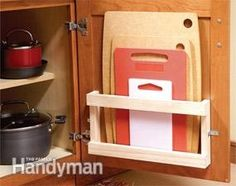 Innovative Kitchen Organization and Storage DIY Projects - Store cutting boards in a magazine rack on the interior of the door. Organisation Hacks, Kitchen Organization, Kitchen Storage, Cabinet Storage, Diy Kitchen, Kitchen Ideas, Organizing Ideas, Kitchen Small, Kitchen Hacks