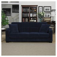 """• Made of iron, wood and polyester<br>• Measures 36""""x86""""x37""""<br><br>Have a sofa by day and bed by night with the Susan Storage Arm Convert-a-Couch® in Navy Blue Velvet from Handy Living. This convertible sofa has a cup holder in the arm rest plus a storage spot for the remote."""