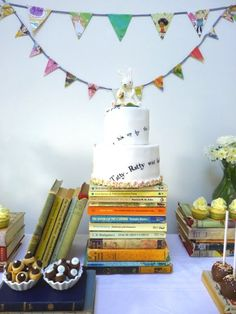Cute writing on the cake and I like how the cake stacked on the books.