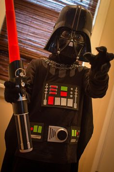 Needed:store-bought Vader masklight saber$1 bin black glovesblack moon bootsblack stocking capblack sweatpantsblack turtleneck1.5 yds black fabric for capered, green, and black fun foam1 gatorade b...