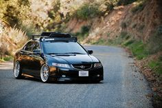I should do this to my TSX...soooo awesome with the bike rack, lowered, and black. <3