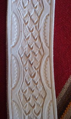 Tooled leather dragon scales for rifle sling by V. Brown of Unforgiven Leather.  This required 6 different leather stamps.