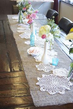 rustic vintage baby shower tables with burlap runners, would want larger vases and old children's books as centerpiece a