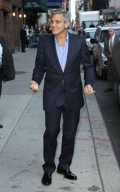 George Clooney navy pinstripe suit light blue shirt, no tie