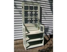 """Repurpose a Door Into an entry table or shelf.  *Use an old screen door: replace the large top section with mirror glass. Leave the small, middle section of screen and stitch a design or message, such as """"Welcome,"""" in the screen"""