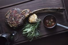Tomahawk Steak at Salt & Char Steakhouse, Saratoga Springs, NY. Photo by Liz Clayman Photography.