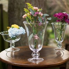 Add floating candles, a floral arrangement, macaroons or candy to our clear glass sundae vase with pedestal base.