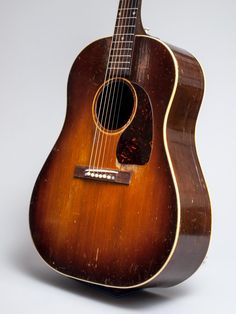 1946 Gibson J-45. This guitar is the only J-45 we have ever seen with a walnut back, mahogany sides and spruce top.   www.trcrandall.com