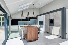 Open plan Industrial style german Nolte kitchen for a classic home