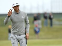 dustin johnson | Dustin Johnson of the United States salutes the crowd on the 15th ...