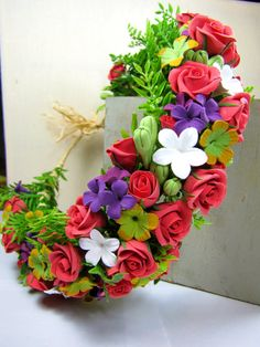 Flower-crown/wreath with roses, lilacs, stefanotises, and pakalanas on Etsy, $150.00