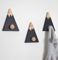 15 Decor Ideas For Creating A Woodland Nursery Design // Mountain hooks add a fun touch to the wall and functionality to the room.