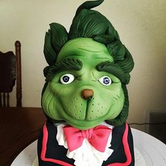 I almost forgot to get a photo of my finished grinch last night I got photos of several from class but forgot mine #cakesbytimbo #grinch #fondant #cakeart #fondantart