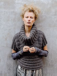Brisk - Knit this ladies top with deep rib cowl neckline from Rowan Knitting & Crochet Magazine 58, a design by Sarah Hatton using the beautiful yarn Fazed Tweed (wool, alpaca and polyamide.) With an allover deep ribbed design that is worked sideways from cuff to cuff, this knitting pattern is suitable for the average knitter.