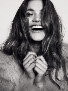 Smile – model caroline corinth, photographer henrick adamsen, black & white, fur jacket
