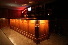Lower level bar with lighting by Wooden Thumb, Inc.