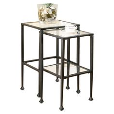 Rest drinks and display your favorite accents atop this charming table, a timeless addition to your home d�cor.   Product: Small and l...