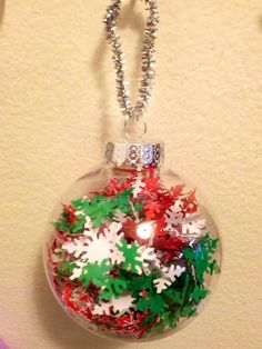 Christmas or holiday ornament  Have your toddler or preschooler stuff in snowflakes cut from holiday craft paper with a martha stewart paper punch. Great for fine motor skills.