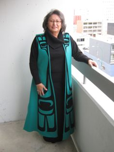 Coat Vest-fully lined teal melton wool long coat vest with back slit and Coast Salish feather design