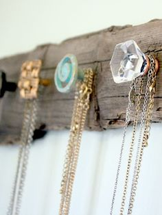 Salvaged wood board and small drawer knobs to hang necklaces