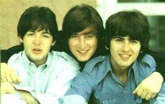 Paul,  John & George Beatles huddle cuddle.