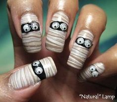"""DIY Halloween Mummy Nails with Tutorial and Video. If someone asked me what my favorite NAIL site was it would be My Simple Little Pleasures . Why do I love this site? Because she takes tons of great photos under different lighting conditions and labels them: """"""""natural' lamp"""", """"camera flash"""", """"shade"""" etc... #halloween #diy #crafts #nails #mummy #mummies #nail_polish #nail_art #googly_eyes by Nora Lina Vazquez"""
