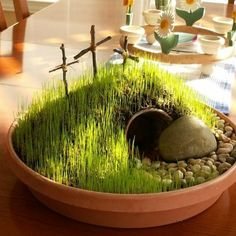 If you have small children, you might like to make a visual coffee tablescape using potting soil, a tiny buried flower pot for the tomb, shade grass seed, and a cross...