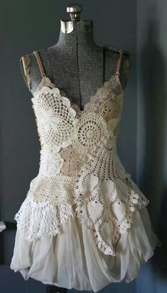 There's parts of this I don't like, but I like the concept.   It's different. hmmmmmm.....Doily dress