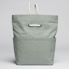 Dual-Backpack- Coated Cotton- Oyster- Leather- Stone- bag- Cord Straps- Handles- Two Inner Pockets- Two Outer Pockets- Fold Over Top-3