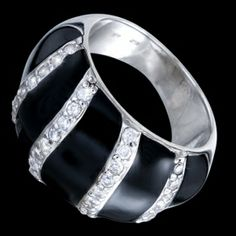 Silver ring, zirconia, luxurious Silver ring, Ag 925/1000 - sterling silver. Sturdy, perfect, luxurious ring - on a black enamel background are stripes of glittering zircons set in pav?�. Rhodium-plated. Height at the place of pattern approx. 14mm, gradually narrows towards to the back up to approx. 5mm.