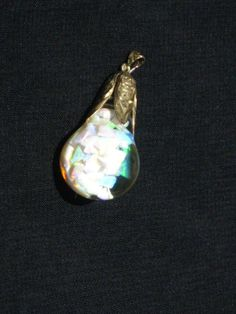 Horace Welch floating opal pendant 14k gold by CanticoNuevo, $249.00