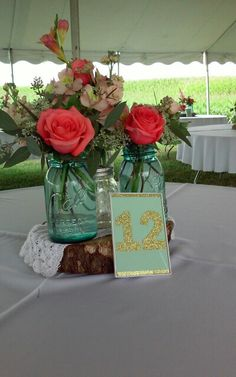 Centerpiece, tent reception, Kelly Agricultural Museum #canningjars #bannerflower