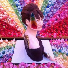 Gizzi Erskine personalised rainbow cake by Tattooed Bakers for the launch party of her latest book. Background mural by Meringue Girls