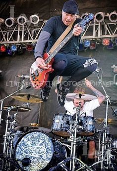 Live concert photography: bassist, Vince Hornsby, and drummer, Morgan Rose, of the heavy metal band Sevendust