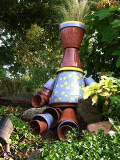 """So clever! """"Pot Lady""""     """"I took standard pots from the garden center and glazed them. I used a clear glaze for the face, neck, arms and legs. I love her new polka-dot dress"""" ~ via Joey Kiernan"""