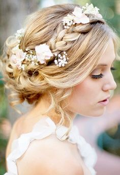 I think this is a very nice hairstyle for a beach wedding. The flowers give it kind of a vintage/beachy look!