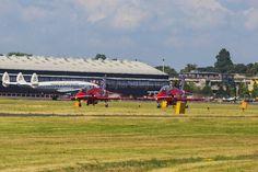RAF Red Arrows in BAE Hawk T1 trainers Farnborough International Airshow Farnborough Airport Rushmoor Hampshire England  www.alamy.com/image-details-popup.asp?ARef=FC31H5  #raf #red #team #jet #airplane #air #plane #display #aviation #airshow #force #hawk #arrows #flight #aerobatic #formation #sky #smoke #aircraft #royal #show #teamwork #military #flying #speed #fast #stunt #british #pilot #wing