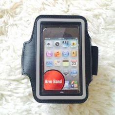 NWT iPhone Armband! NWT iPhone Armband! Never been used  Adjustable velcro strap with a space to hold a key and headphone output. Please note I'm pretty sure this will not hold a iPhone 6. My iphone 5s and old school iPod fit great! Accessories Phone Cases