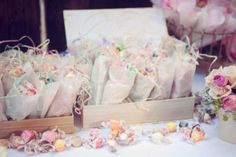 salt water taffy in all the pastel colors for guest favors.  Add a little pastel colored paper shreds for the perfect package.