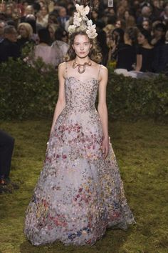 The flowers on the dress seem to be appliques, not entirely sewn down. Would create beautiful movement...  Lilacs & Lace: Return to Dior