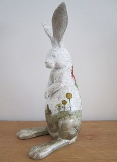 This is an original, mixed media sculpture. The rabbit measures 5 x 11 x 6 The rabbit is made of resin and has been been altered over every