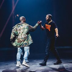 Kanye West wearing a The Life of Pablo jacket with Drake wearing a Revenge T-shirt