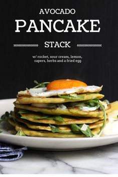 Avocado pancake stack w/ rocket, lemon, capers, parmesan, sour cream , herbs and a fried egg. #glutenfree recipe on dancingthroughsunday.com.au