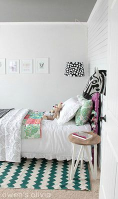 Adorable girl's bedroom with white wall paneling painted Benjamin Moore Decorator's White accented with Anthropologie Savannah Story Bust - Zebra over Target nightstand and Urban Outfitters Zigzag Rug. White Girls Rooms, Teen Girl Bedrooms, Big Girl Rooms, White Wall Bedroom, Home Bedroom, Bedroom Decor, Bedroom Ideas, Extra Bedroom, Dream Bedroom