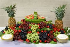 fresh fruit display | bounty of fresh fruit is piled high into a display. —Photo by ...
