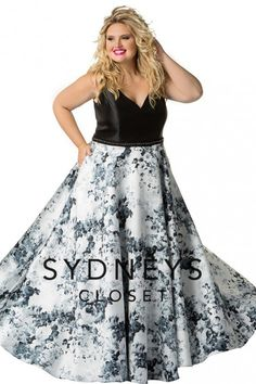 Style SC7249 from Sydneys Closet is a softly swinging, fully lined Mikado satin plus size prom dress. The floral print A-line skirt dusts the floor while the sleeveless V neck bodice has bra-friendly straps and a V back. natural waistline with a center-back zipper. The matching belt sparkles with black metallic round beads at the natural waist, and the center-back zipper completes the look.
