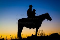 Silhouette of cowboy on horse, and his dog, at sunrise   Inge ...